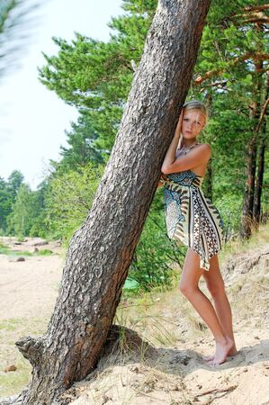 Portrait of the beautiful woman at the tree photo