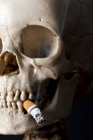 Smoking human scull with sigarette in his mouth photo