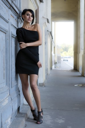 City Portrait of the beautiful woman in a black dress  photo