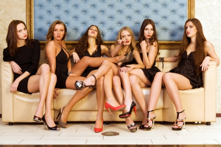 Group of the beautiful model in a black dresses  Stock Photo