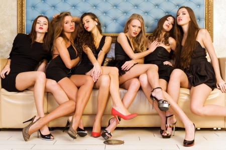 waiting girl: Group portrait of models in black dresses