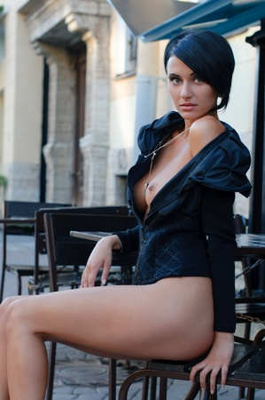 naked breast: Beautiful Woman with naked breast in the cafe outdoors
