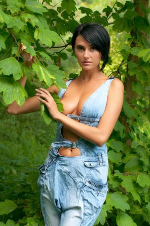 Portrait of the beautiful woman in jeans overall photo