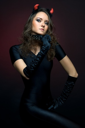 Portrait of the beautiful young woman in devil costume Stock Photo - 8414461