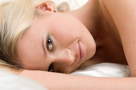 woman night: Portrait of the beautiful blonde lying on the bed Stock Photo