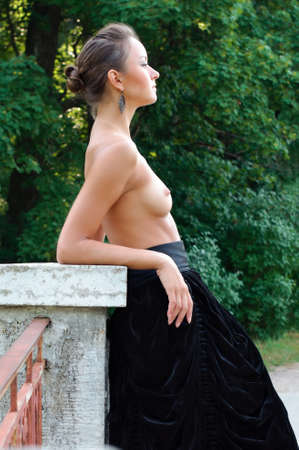 naked breast: Summer garden. beautiful woman with naked breast in long skirt Stock Photo