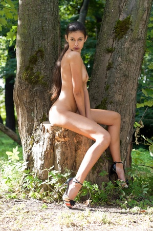 naked breast: Portrait of the beautiful naked woman at the tree in the forest