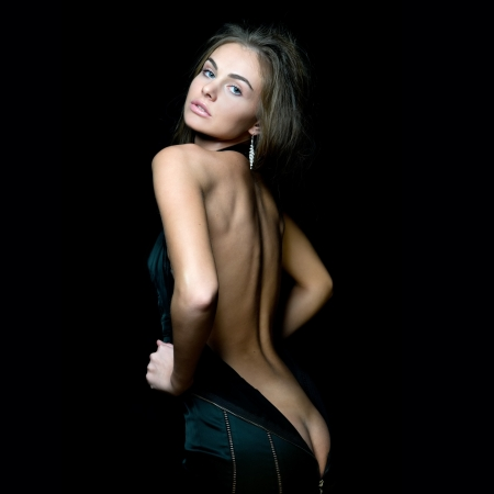 Portrait of the beautiful woman with naked back Stock Photo