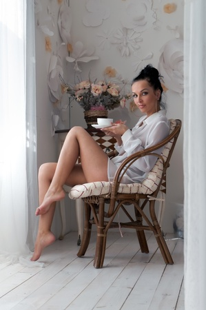 hotel suite: Portrait of the beautiful woman drinking tea in the morning