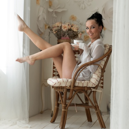 suite: Portrait of the beautiful woman drinking tea in the morning