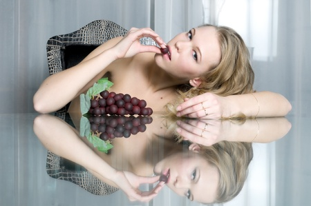 Luxury Portrait of the beautiful blonde with grape   photo