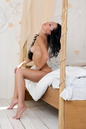 Portrait of the beautiful woman in the bedroom. Fashionable obsolete interior Stock Photo - 9801057
