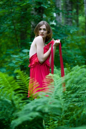 nude outdoors: Portrait of the beautiful woman with naked back. In summer forest