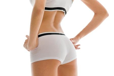 nalga: Mujer de espalda y las nalgas. Alejado de la imagen