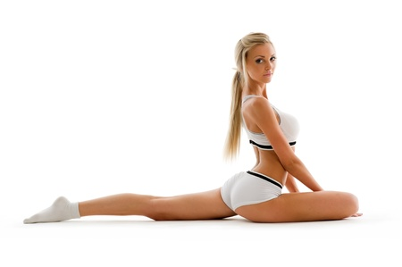 Beautiful blonde in sport wear is making exercises. Isolated image Stock Photo - 10409184