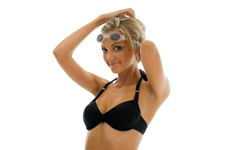 sportwoman: Young beautiful sportwoman in swimsuit with swimming goggles Stock Photo