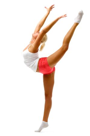 Young woman is making gymnastic exercises