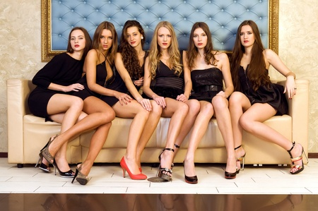 indoor photo: Six beautiful sexy models are sitting on the sofa