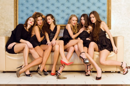gold bar: Six beautiful sexy models are sitting on the sofa