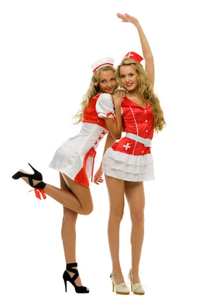 Two women in fansy nurse shape. Halloween and Christmas theme. Isolated image photo