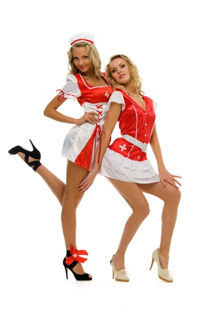 Two women in fansy nurse shape. Halloween and Christmas theme. Isolated image Stock Photo - 10647633
