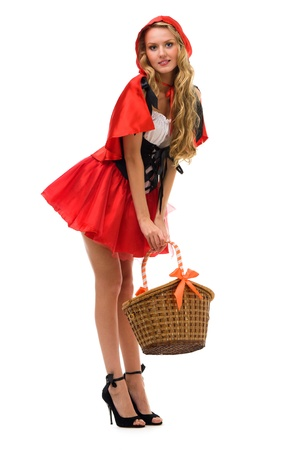 woman in fansy costume. Little Red Riding Hood shape.Halloween and Christmas theme. Isolated image