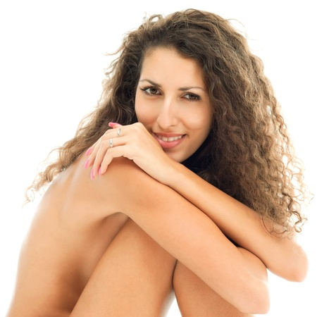 undressed: Naked sitting beautiful woman with curly hair. Isolated image Stock Photo