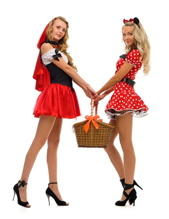 Two women in carnival costume.   Little Red Riding Hood and mouse shape. Isolated image photo