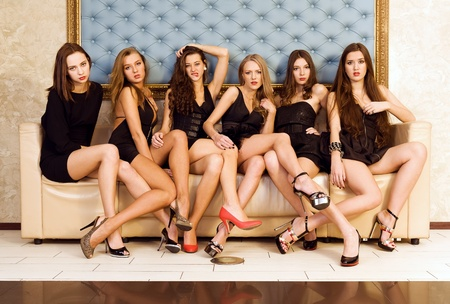 Six beautiful sexy models are sitting on the sofa photo