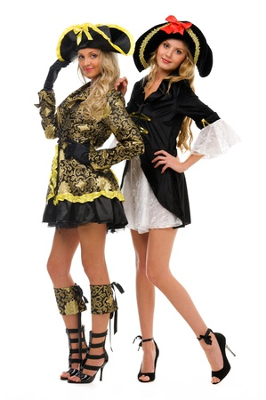 Two beautiful women in carnival costumes. Pirate and empress shape. Isolated image photo
