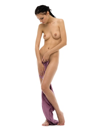 Portrait of the beautiful naked woman in a towel. Isolated image