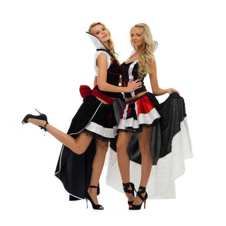 Two beautiful women in domino costumes. Isolated image photo