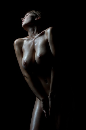 Naked woman with big breast. Monochrome image.