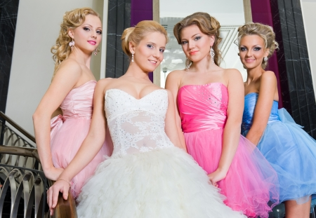 Beautiful bride with her  bridesmaids in the beautiful interior