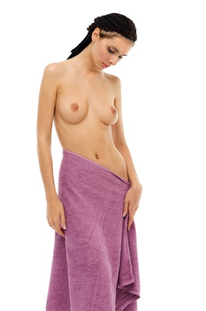 women breast: Young beautiful naked woman in a towel Stock Photo