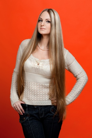 Studio portrait of the beautiful woman with very long hair. Stock Photo