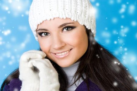Portrait of the beautiful woman in winter fashion. Snowflake imitation. photo