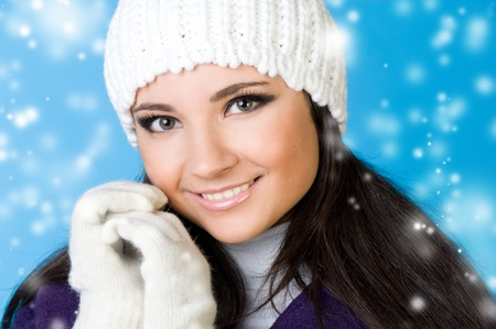 winter woman: Portrait of the beautiful woman in winter fashion. Snowflake imitation.