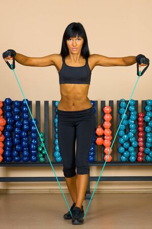 beautiful woman is doing exercises in the sport club. Stock Photo - 11547523