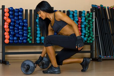 beautiful woman is doing exercises in the sport club. Stock Photo - 11547479