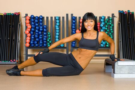 Beautiful woman doing exercises in the sport club. Stock Photo - 11771677