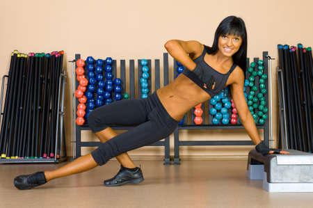 beautiful woman is doing exercises in the sport club. Stock Photo - 11771576