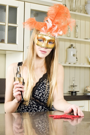 Woman in the interior. Beautiful blonde in a venetian mask.