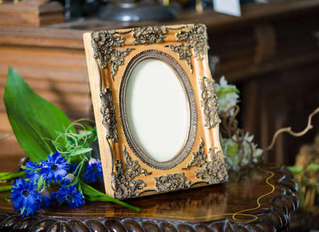 emptiness: Still life with antique ornate frame.