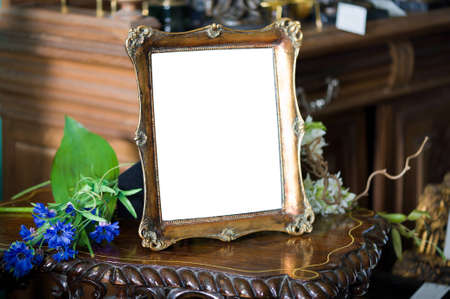 Still life with antique frame with womans portrait  and flowers. photo