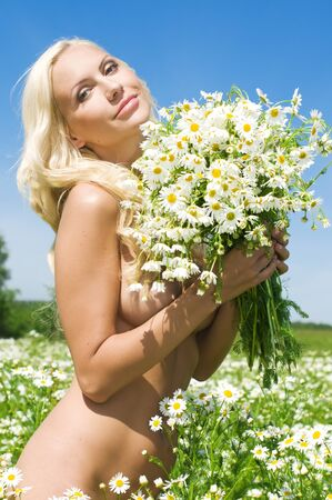 Portrait of the beautiful woman on the meadow photo