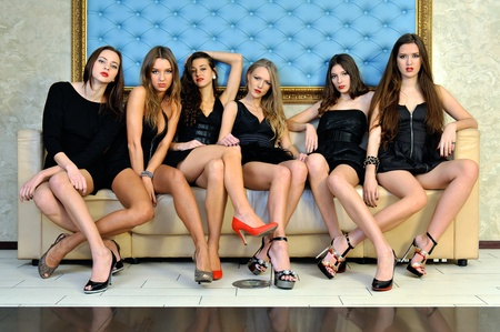 Six beautiful sexy models are sitting on the sofa Stock Photo - 12889304