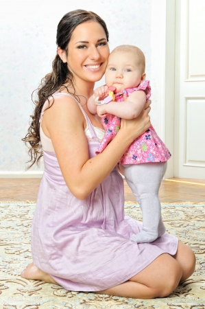 2 5 months: Beautiful mother with her newborn baby.