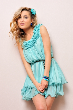 Beautiful blonde in blue dress, Studio portrait. photo