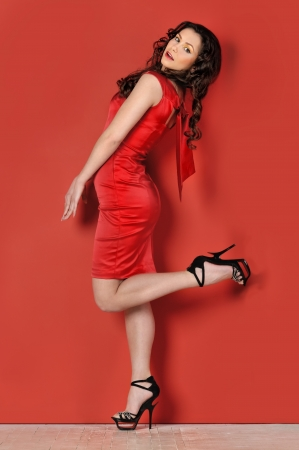 Portrait of the beautiful woman in a red dress. photo